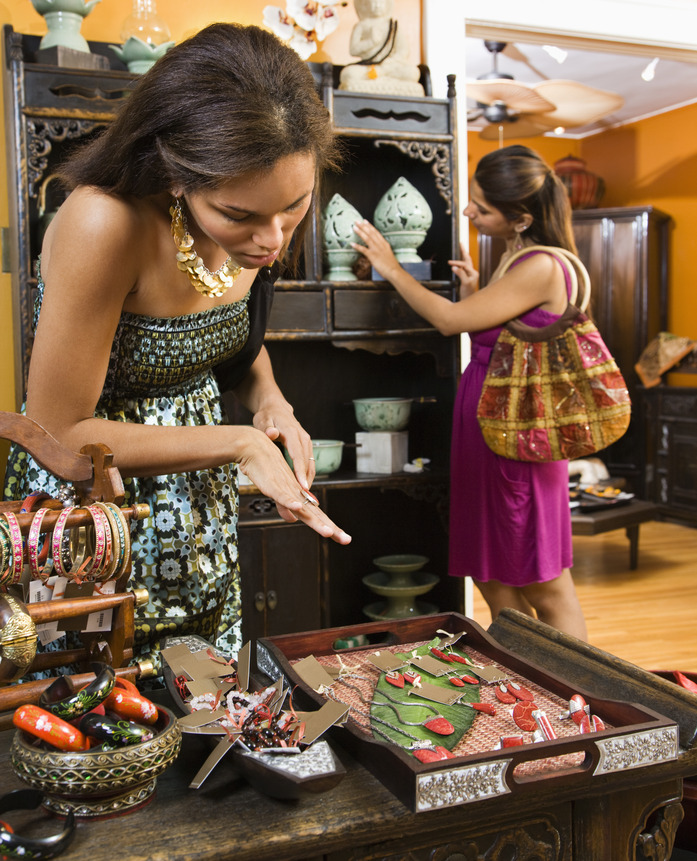 African American and Indian women shopping  in boutique.